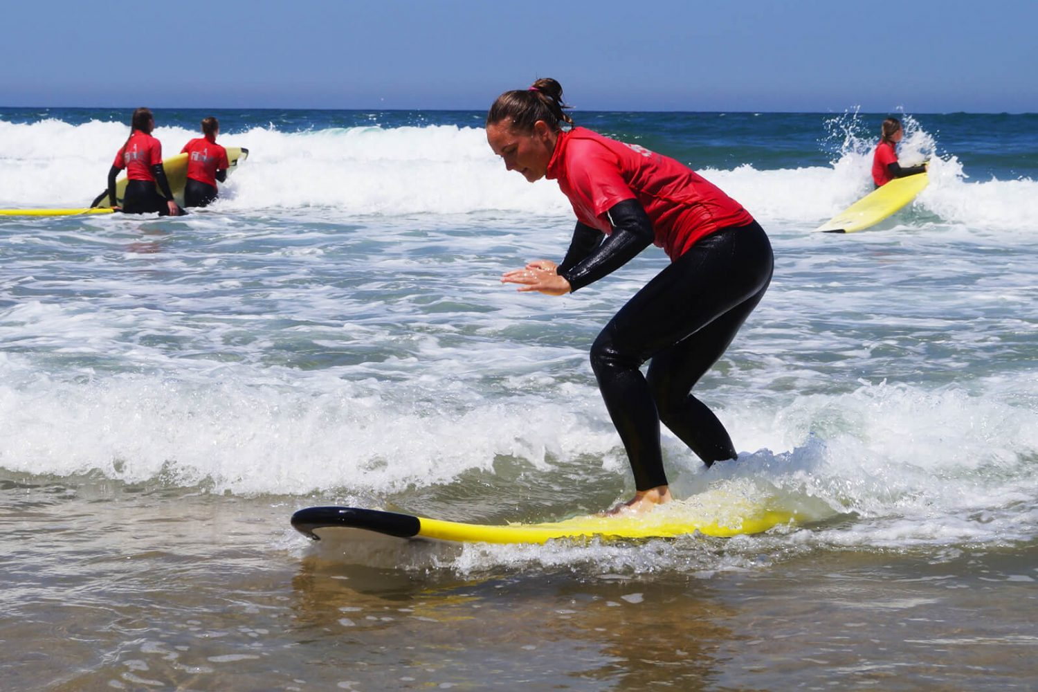 woman learning surf lagos